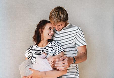 happy family breast feeding